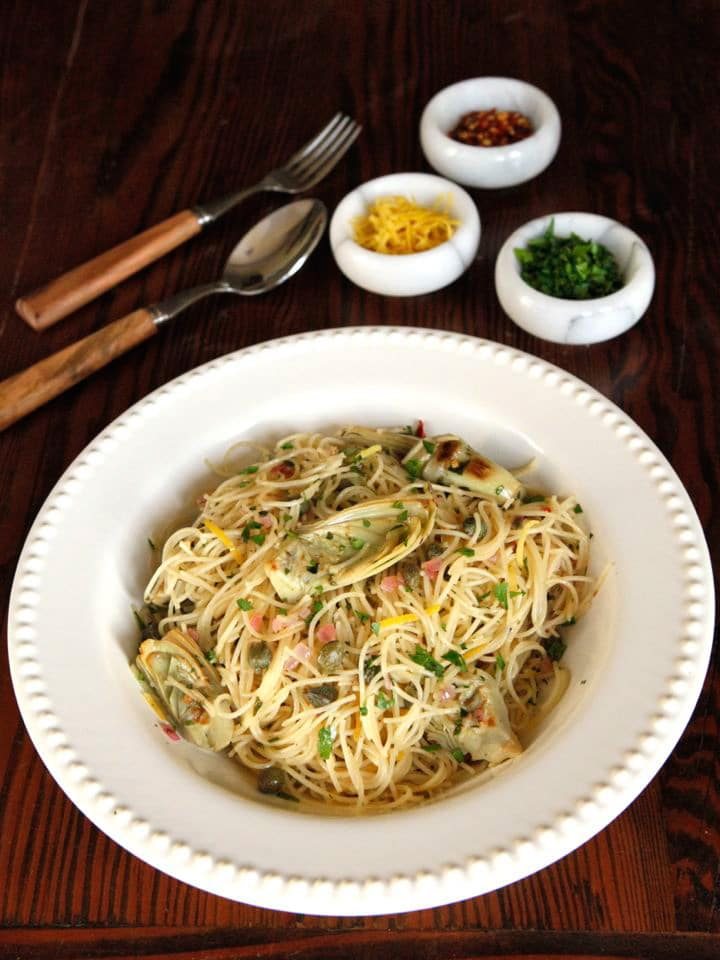 \Lemon Butter Pasta with Artichokes and Capers - A delicious spring-inspired, easy and flavorful recipe for meatless meal by Tori Avey.