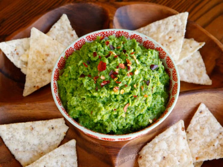 Spring Pea Guacamole - Recipe for light and healthy guacamole-style dip. Lower fat alternative to avocado guacamole. Made with spring peas, jalapeño, lemon, herbs and spices.