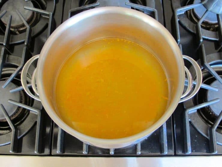 Orange juice in a large stockpot.