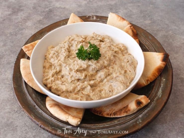 Creamy Baba Ghanoush - Recipe for luscious Middle Eastern roasted eggplant dip, rich with sesame tahini. Healthy and tasty!