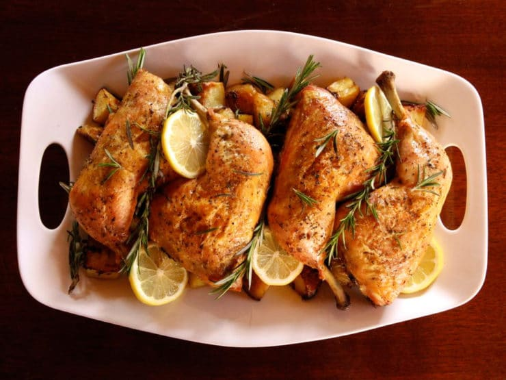 Rosemary Roasted Chicken and Potatoes - Easy, healthy, one-pan meal. Seasoned chicken pieces roasted on a bed of potatoes, garlic, lemon and fresh rosemary. Simple, elegant entree.