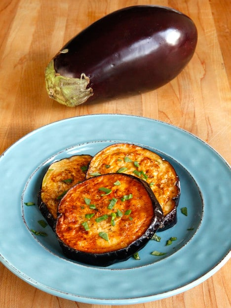 How to Fry Eggplant with Less Oil -Learn to fry eggplant slices perfectly golden crisp without getting soggy or oil-soaked on ToriAvey.com. Healthier frying method for eggplant.