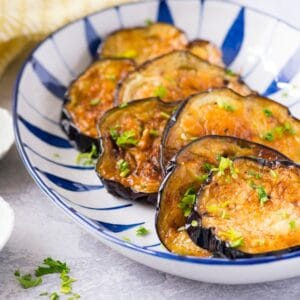 Plate of fried eggplant cooked golden crisp