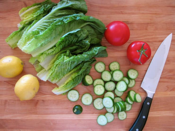 Various chopped vegetables on a cutting board.
