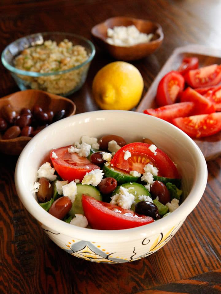 Greek Salad Quinoa Bowl Recipe - Healthy protein-packed Mediterranean vegetarian recipe with quinoa, chickpeas, herbs, Greek salad and feta