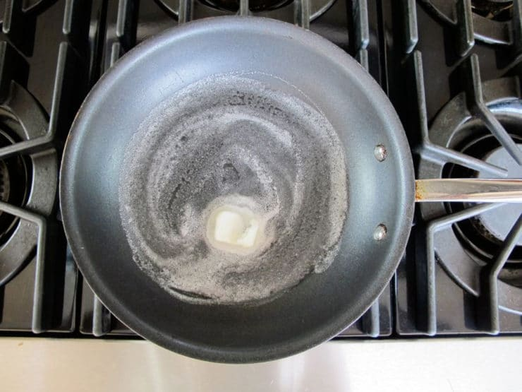 Melted butter in a nonstick skillet.