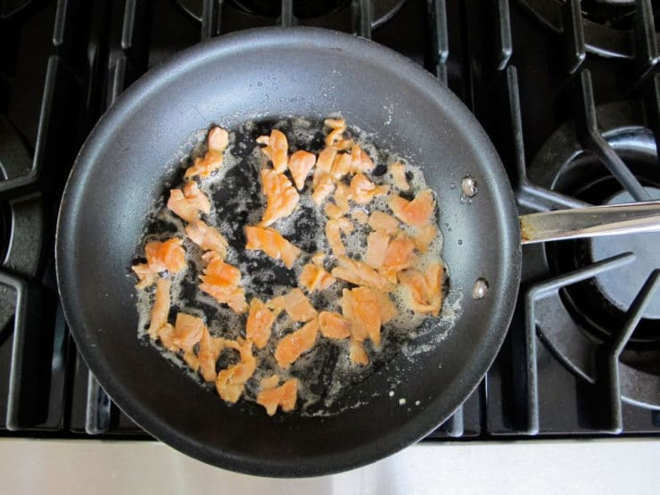 Lox pieces frying in butter.