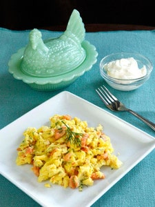Smoked Salmon Goat Cheese Scramble - Irresistible breakfast recipe with fluffy scrambled eggs, creamy goat cheese, smoked salmon and fresh dill by Tori Avey.