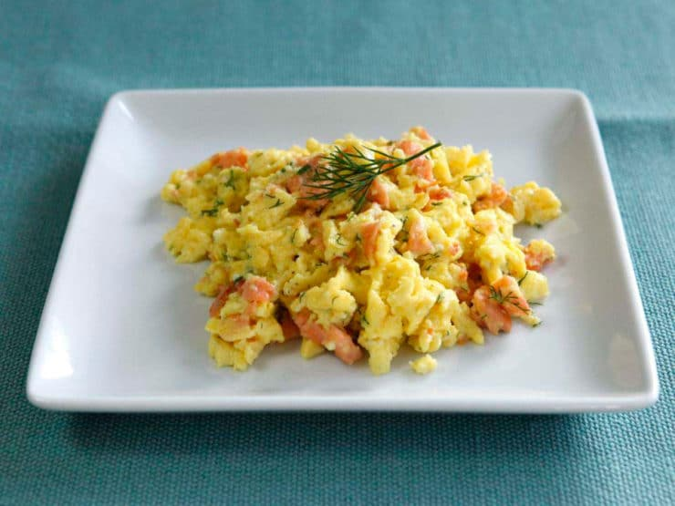 Smoked Salmon Goat Cheese Scramble - Irresistible breakfast or brunch recipe with fluffy scrambled eggs, creamy goat cheese, smoked salmon and fresh dill by Tori Avey.