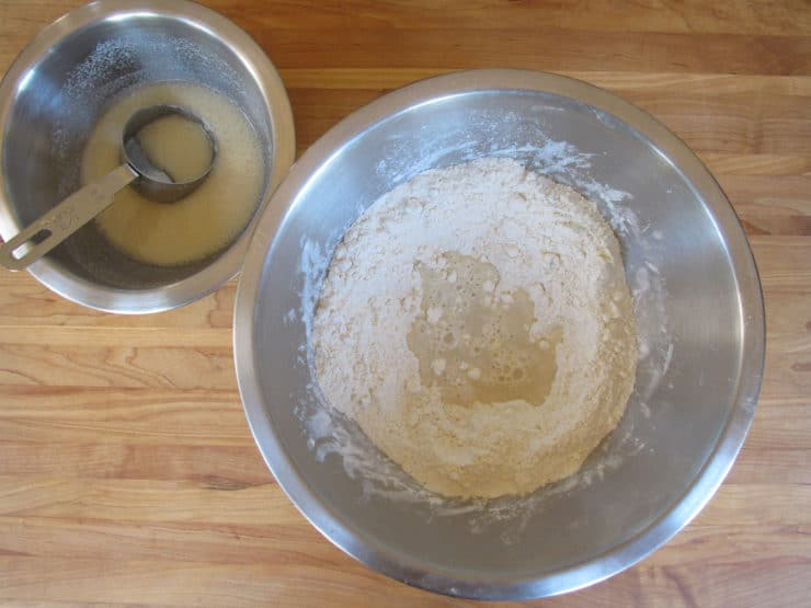 Making a well in flour for wet ingredients.