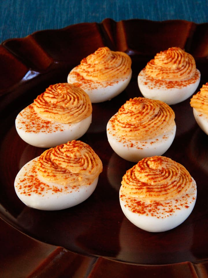 Hummus Sriracha Deviled Eggs - Spiced up, lightened up, smoky deviled eggs recipe. Lower cholesterol and lower fat than traditional deviled eggs, with an addictive spicy kick.