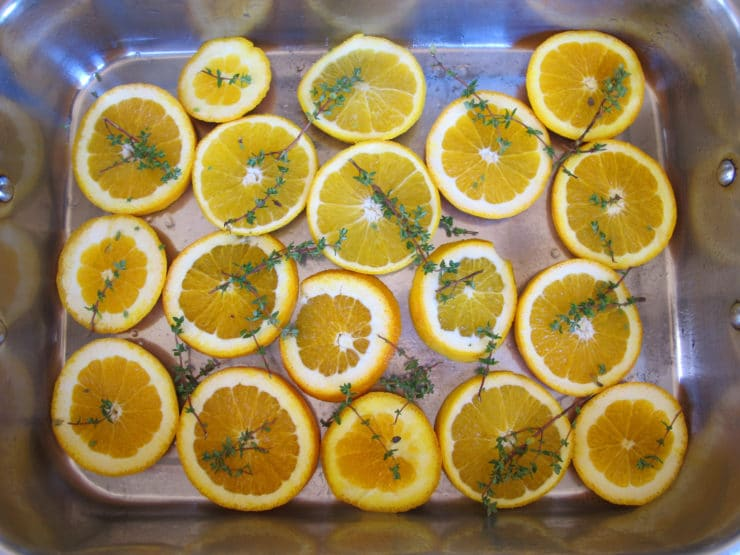 Orange slices on a baking sheet.