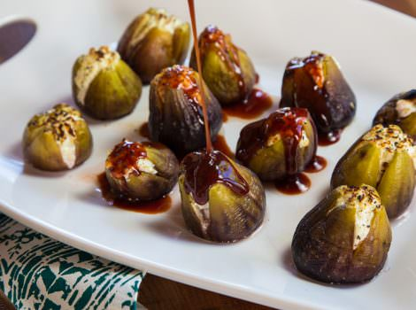 Pouring honey over stuffed figs.
