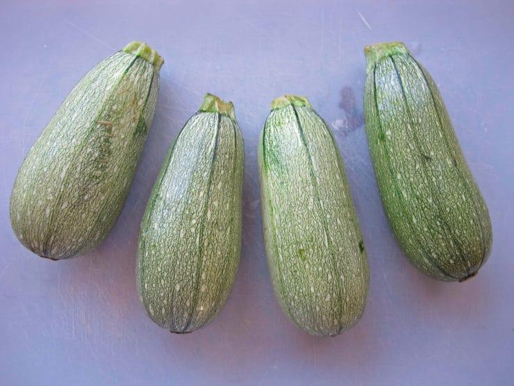 4 light green zucchinis.