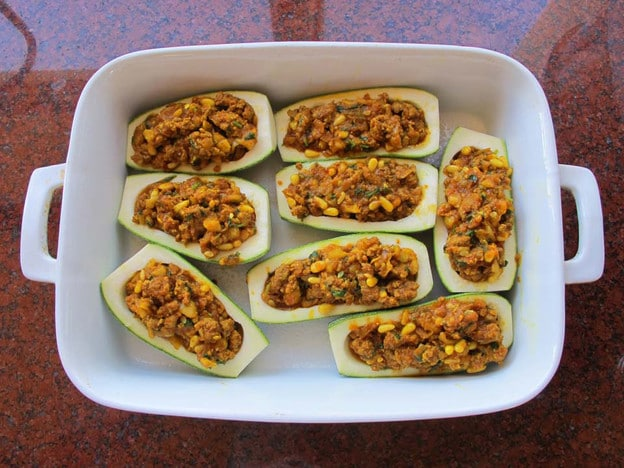Recipe for Stuffed Zucchini with ground beef or lamb, pine nuts, tomato sauce and spices. Low carb, paleo, grain free.