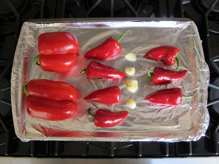 Peppers on a foil lined baking sheet.