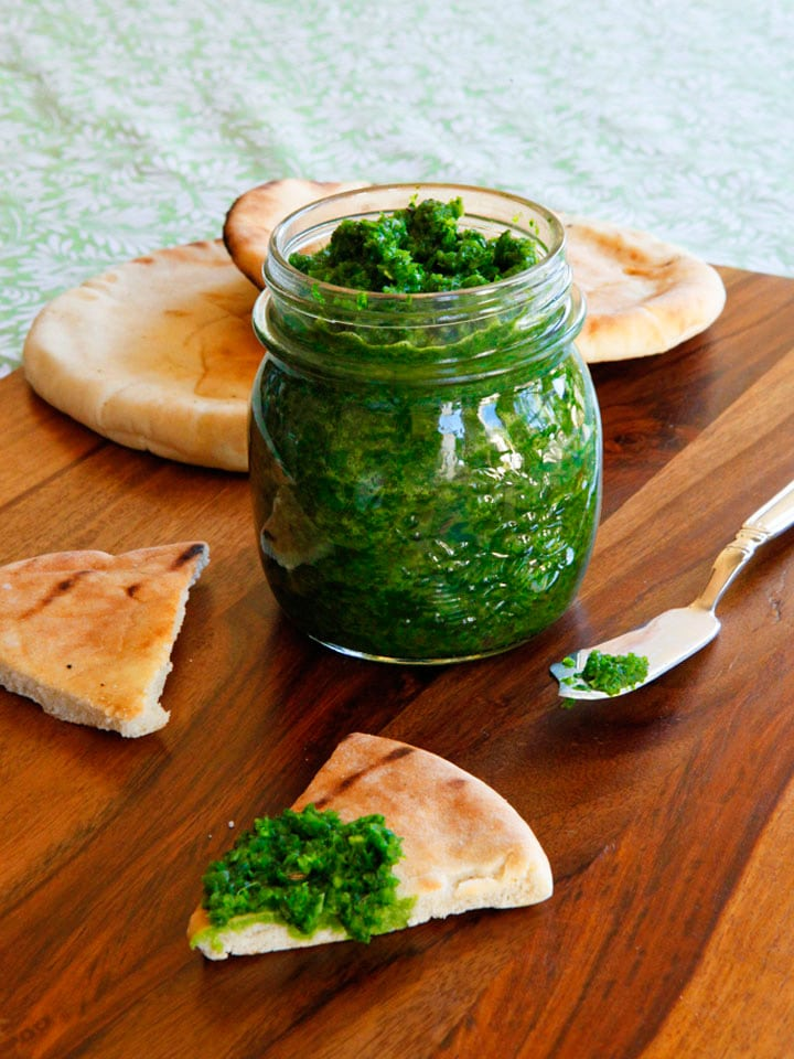 Yemenite Schug - Easy recipe for fiery, herby green Yemenite sauce with cilantro, parsley, jalapeños, garlic, spices and salt. Adds a spicy kick to all kinds of foods.