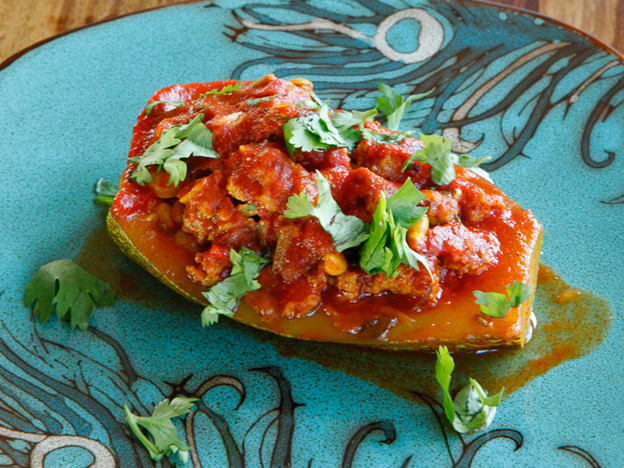 Stuffed Zucchini with ground beef or lamb, pine nuts, tomato sauce and spices. Low carb, paleo, gluten free, grain free.