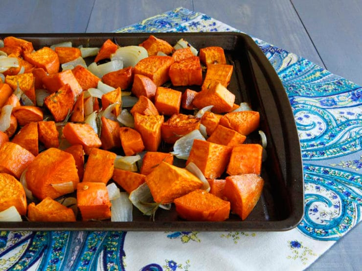 Spicy Roasted Sweet Potatoes with Sweet Onion, Rosemary & Chili Flakes - Healthy roasted yams with sweet Maui onions, fragrant rosemary and spicy chili pepper flakes. Healthy and flavorful cold weather vegan side dish.
