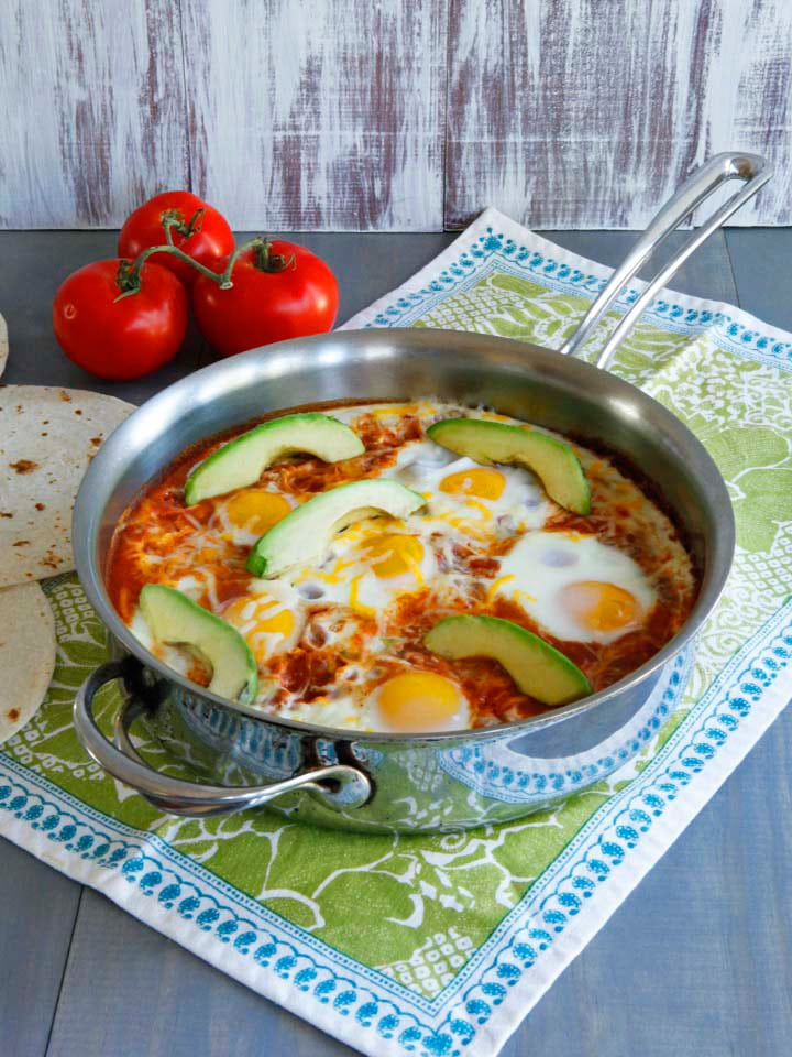 Huevos Shakshukos, Shashuka Recipe with a Mexican Twist - Two tasty egg dishes from two different parts of the world unite to make one tasty spiced-up breakfast dish. Gluten free, vegetarian, healthy.