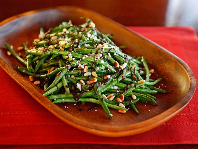 Green Beans with Balsamic Date Reduction Feta & Pine Nuts - Healthy vegetarian side dish recipe for sauteed green beans with balsamic date reduction sauce, crumbled feta and toasted pine nuts.