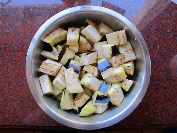 Diced eggplant tossed with olive oil.
