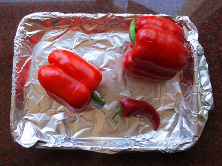 Peppers on a foil-lined baking sheet.