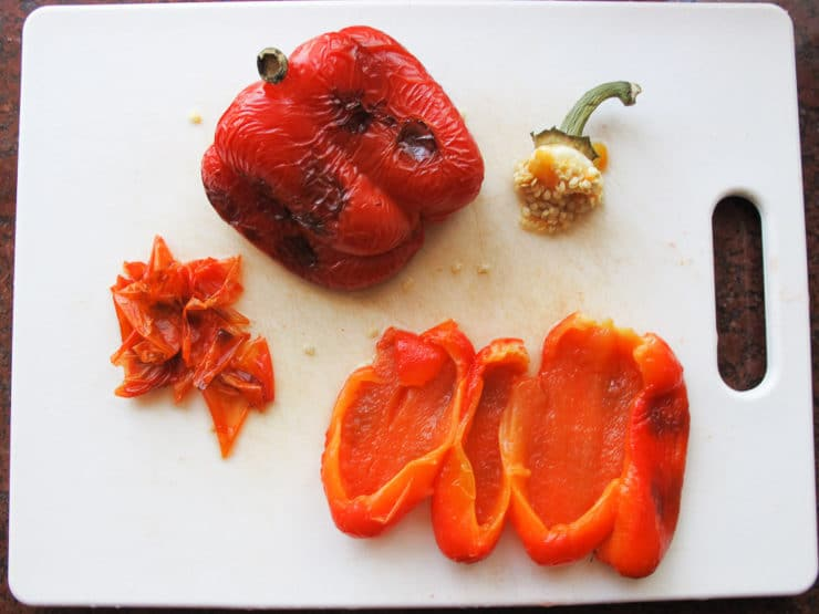 Peeling and seeding roasted peppers.