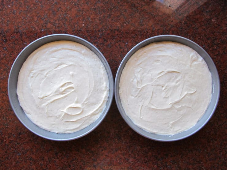 Cake batter divided into two round pans.