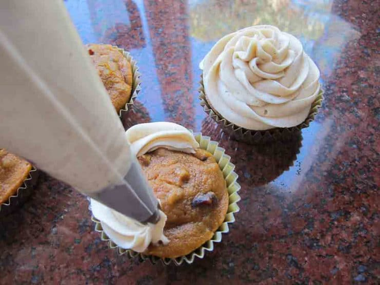 Frosting cupcakes with a star tip.