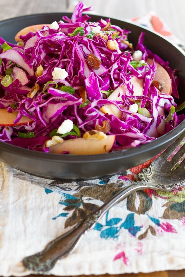 Red Cabbage Apple Salad with Blue Cheese & Walnuts - Unique and delicious cabbage salad recipe with apples, blue cheese, toasted walnuts, dates, green onions, mint and a tantalizing creamy dressing.