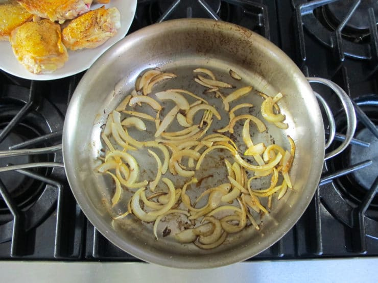 Sliced onions in saute pan.
