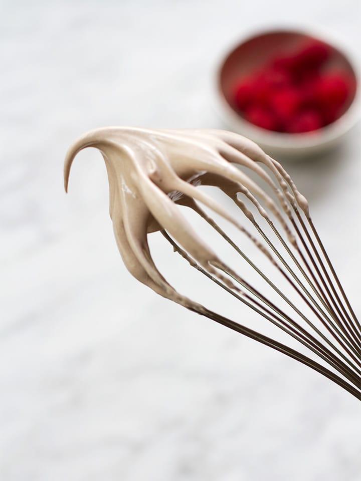 Stiff meringue on a whisk.
