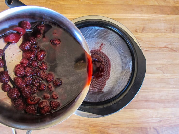 Straining blackberries.