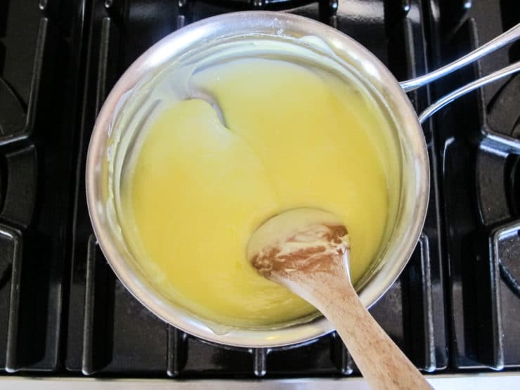Finished lemon curd in saucepan.