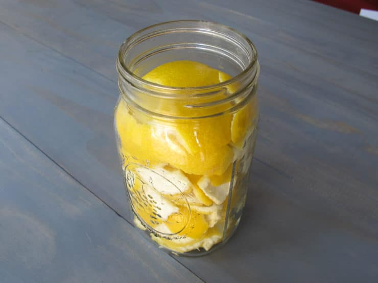 Lemon peels in open mason jar.