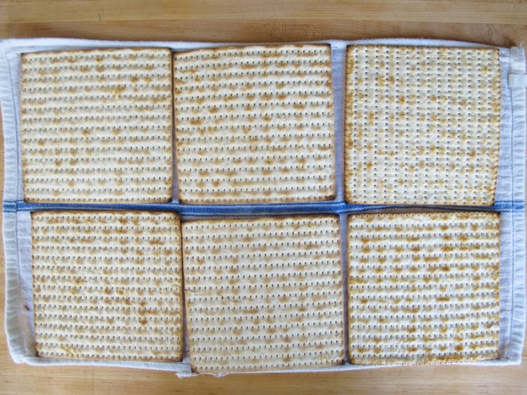 Matzo crackers on a dish towel.