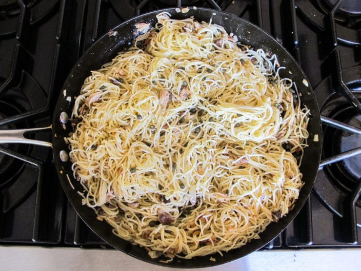 Pasta added to saute pan.