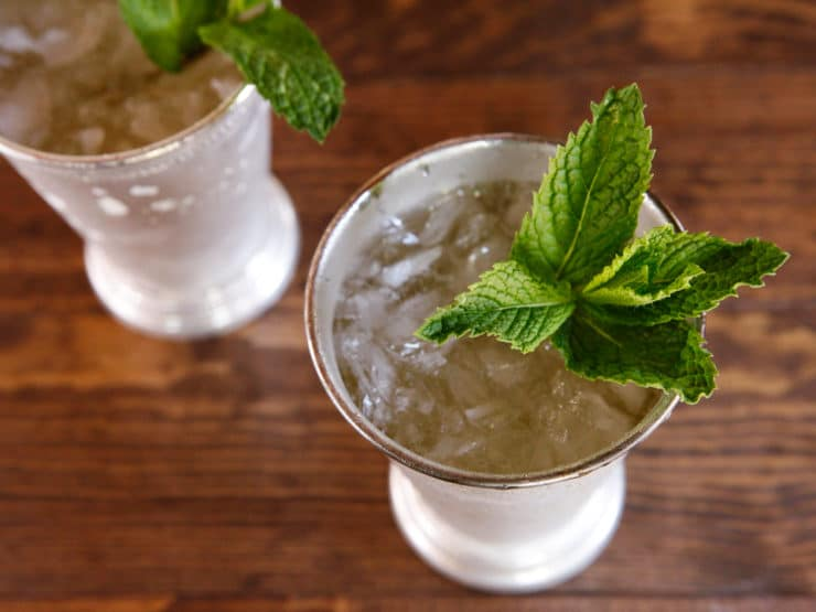History of the Mint Julep - A history of the mint julep cocktail, a favorite southern cocktail served each year at the Kentucky Derby.