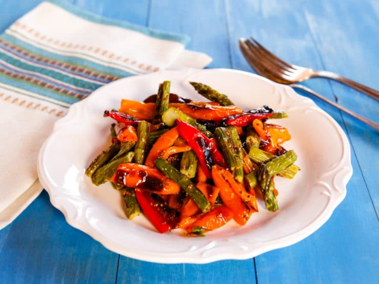 Roasted Sweet Mini Peppers and Asparagus - Roasted asparagus and sweet roasted mini peppers with a delicious simple dressing. Easy, healthy, flavorful and colorful vegan side dish.