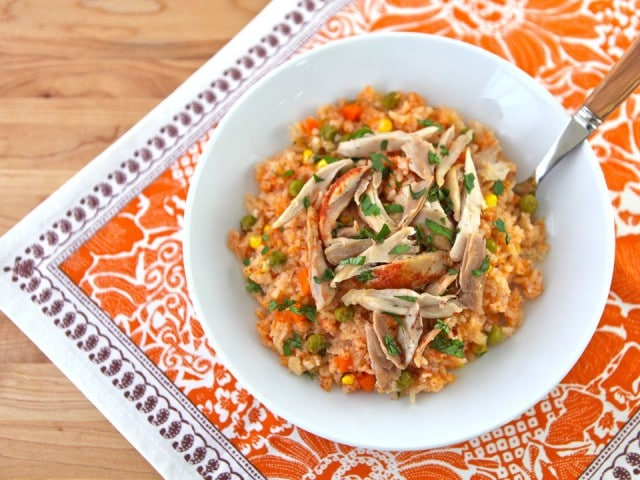 Mexican Arroz con Pollo- tomato vegetable rice, garlic and onion slow cooked with tender chicken. Easy healthy affordable one pot meal
