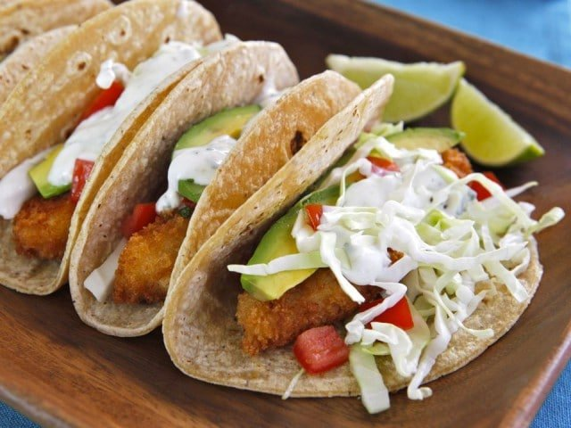 Crispy Panko Fish Tacos - Recipe for beer battered panko fish tacos. Fried fish with perfect crunch & amazing flavor. Sour cream lime sauce. Mexican recipe with a twist.