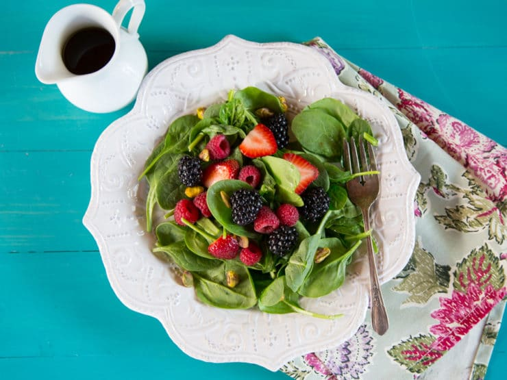 Spring Berry Pistachio Salad with Maple Balsamic Vinaigrette - Recipe for fresh vegan spinach salad with ripe berries topped with a tangy sweet maple balsamic vinaigrette.
