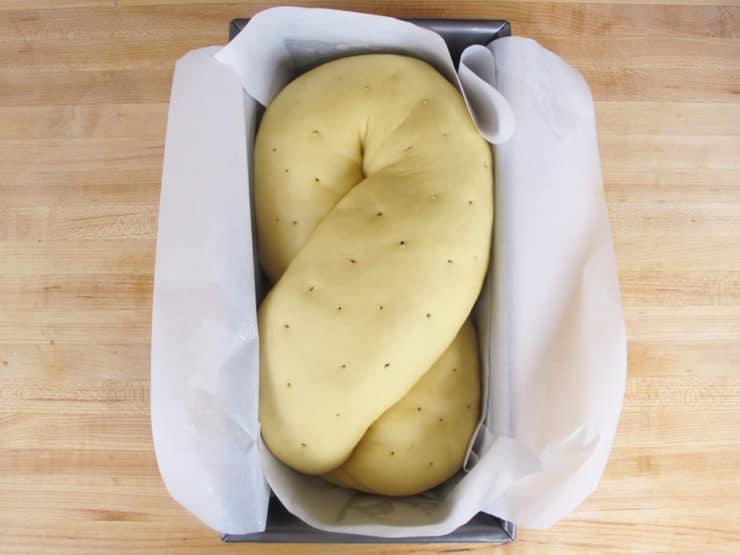 Dough risen in a loaf pan.