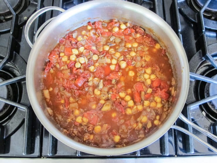 Tomatoes added to vegetables for soup.