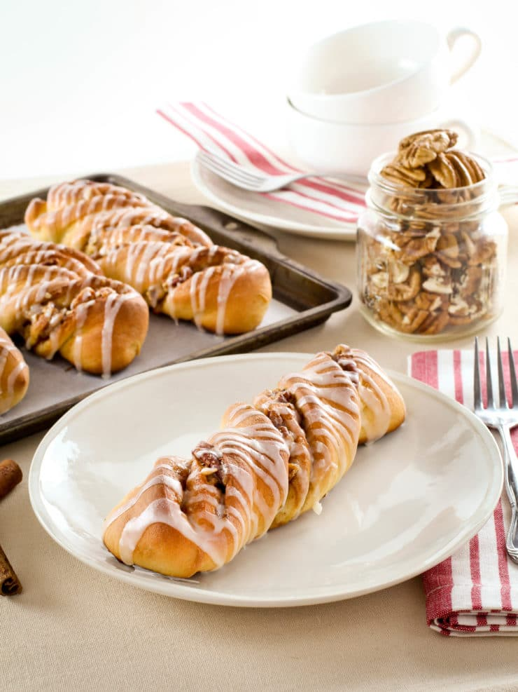 Pecan Rolls - Kelly Jaggers shares a recipe for sweet yeast rolls or twists with sweet cinnamon pecan filling and vanilla glaze. Time-tested family recipe.