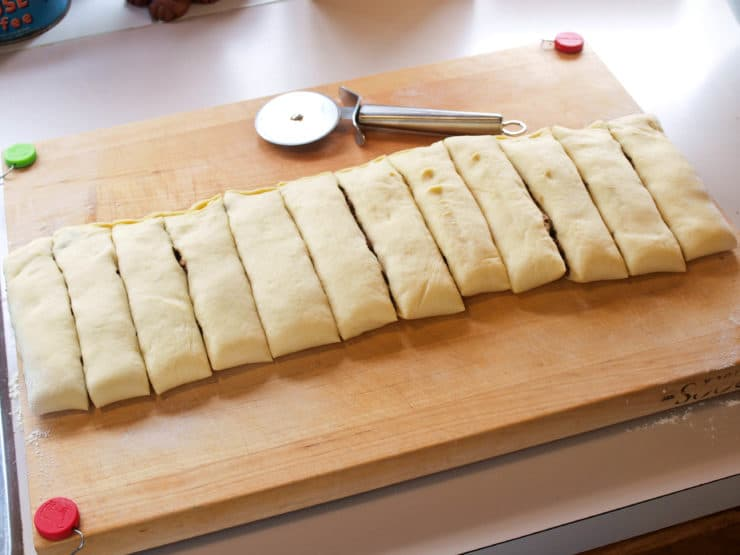 Rolled dough cut into 12 sections.