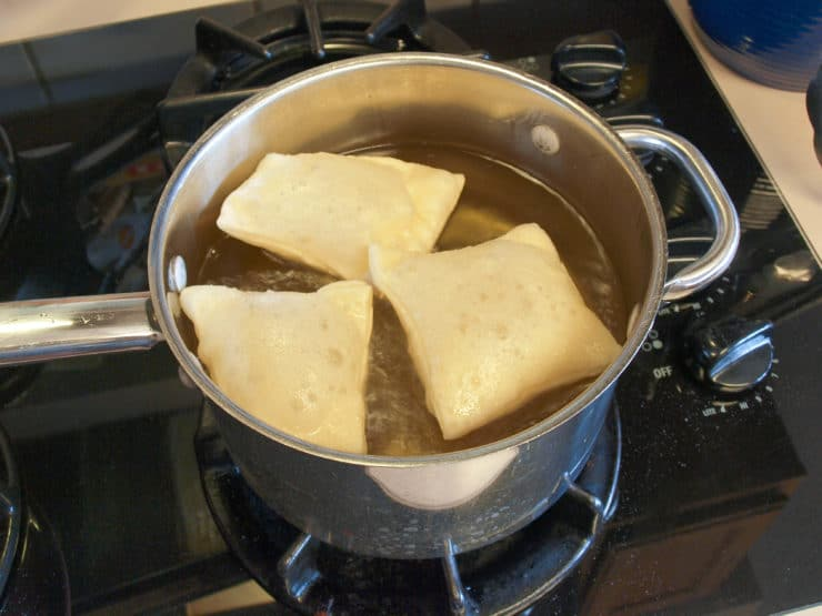 Sopapillas frying on the stove.