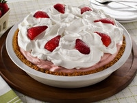 Strawberry Chiffon Pie - Light and Fluffy Strawberry Filling Inside of a Crisp Graham Cracker Crust and Topped with Whipped Cream. Time-Tested Family Recipe.