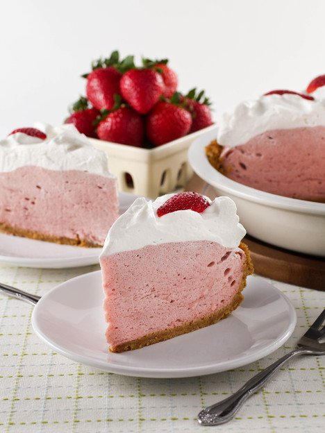 Strawberry Chiffon Pie - Light and Fluffy Strawberry Filling Inside of a Crisp Graham Cracker Crust and Topped with Whipped Cream. Time-Tested Family Recipe from Kelly Jaggers.